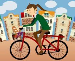 自転車で街中を走る女性のイラスト