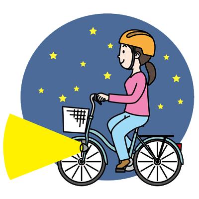 夜間にライトを点灯させて走行する自転車